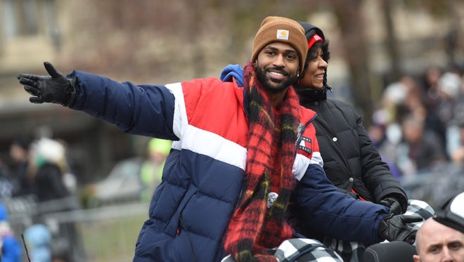 Co-grand marshal Big Sean greets the crowd, accompanied by his mother Myra Anderson.