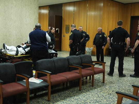 Jelani Mighty, 27, of Rochester injured his hand punching the courtroom door window after sentencing of a relative at the Hall of Justice.  He was taken to Strong Memorial Hospital.  He was also charged with fourth-degree criminal mischief and disorderly conduct, both misdemeanors.  The  open courtroom door has the broken window.