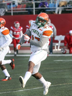 Linebacker Akil Blount celebrates after blocking a field goal against Delaware State last Saturday.