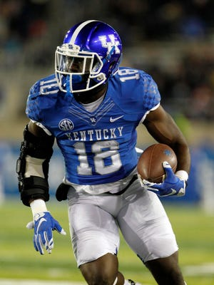 Nov 21, 2015; Lexington, KY, USA; Kentucky Wildcats running back Stanley Boom Williams (18) runs the ball against the Charlotte 49ers in the first quarter at Commonwealth Stadium.