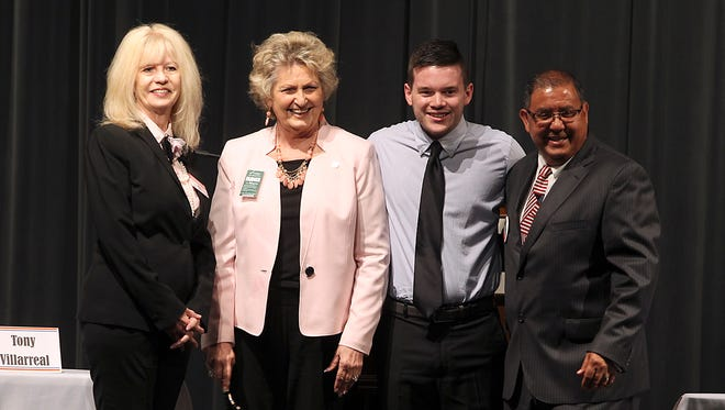 Candidates (left to right) Brenda Gunter, Charlotte Farmer, Zach Taylor and Tony Villarreal pose for photos after answering questions at the mayoral forum held inside the Sarah Bernhardt Theatre at Central High School Tuesday, March 29, 2017.