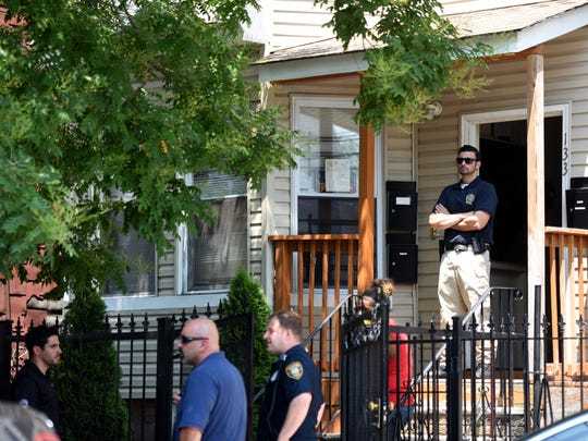 Police, along with family and friends of Jose Segura 44, gather outside of his apartment at 133 Godwin Ave. in Paterson on Monday, July 2, 2018 after finding out Segura was involved in a murder suicide at the Knights Inn on Rt. 46 in South Hackensack