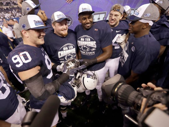 Penn State players celebrate after defeating Wisconsin