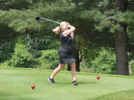 Putnam County Executive MaryEllen Odell tees off at her June 11 golf outing.