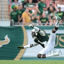 Sep 6, 2014; Tampa, FL, USA; South Florida Bulls defensive back Chris Dunkley (1) dives for a loose ball in the second half against the Maryland Terrapins at Raymond James Stadium. Mandatory Credit: Jonathan Dyer-USA TODAY Sports