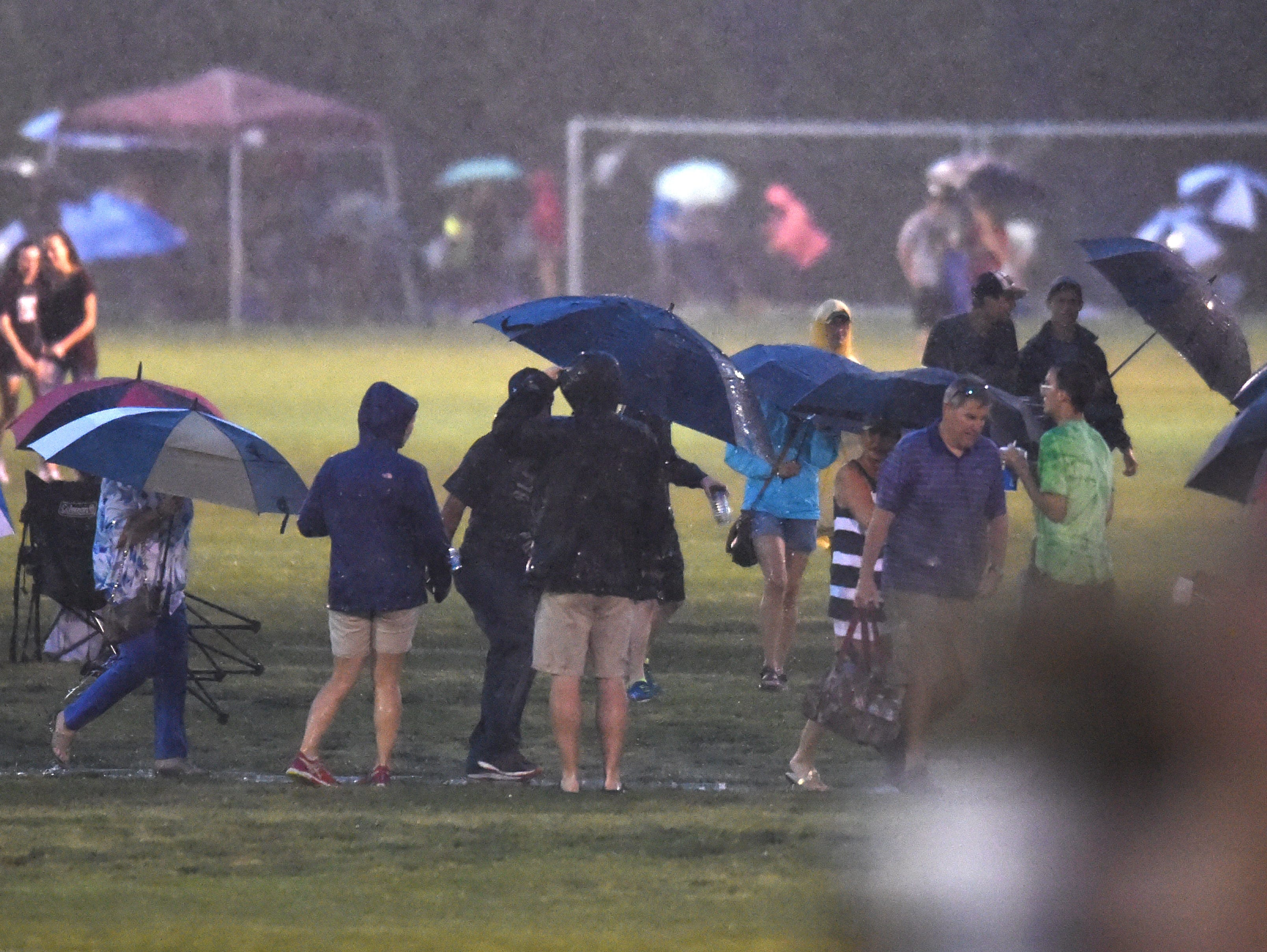 Spectators Search For Shelter At Richard Siegel Soccer Complex During A Lightning Delay Spring Fling