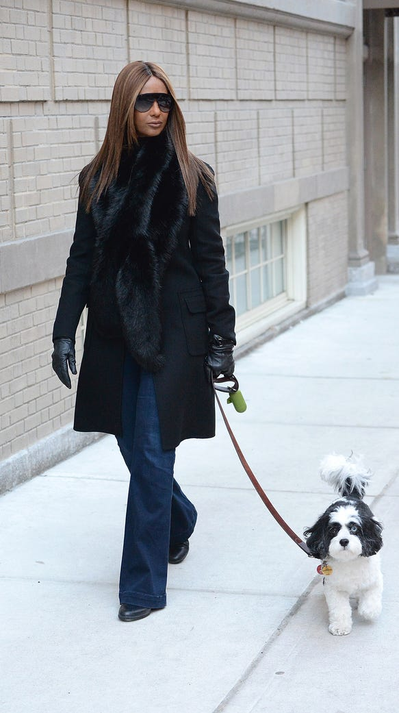Iman walks her dog in her New York neighborhood, for