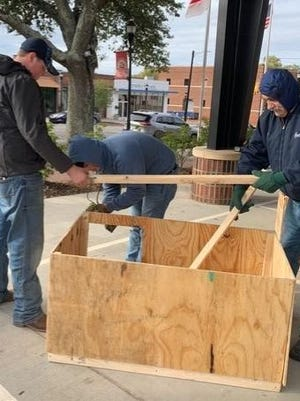 Volunteers build a dog house at the 2019 Dog House Derby. The annual event will take place Saturday morning at Animal Control.