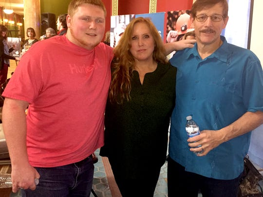 Austin Brentlinger of Sheridan, pictured with his parents Buff and Dean, lost fingers to an irrigating injury on a ranch. He couldn't use his right hand for a year and made use of workers' compensation through the Montana State Fund.