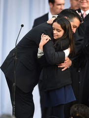 Nevada Governor Brian Sandoval gets a big hug from daughter Marisa after being sworn into office on the steps of the Capitol on Monday Jan. 5, 2014.