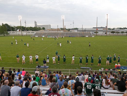 Fans take in a Indianapolis AlleyCats Ultimate Disc game against Madison Radicals at Kuntz Stadium Saturday June 7, 2014.