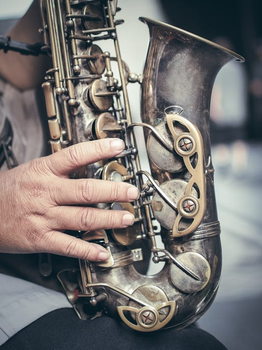Saxophone in the hands
