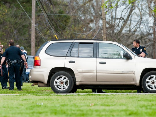 Montgomery Police work the scene of a shooting in a field adjacent to Lee High School in Montgomery, Ala. on Thursday March 16, 2017.