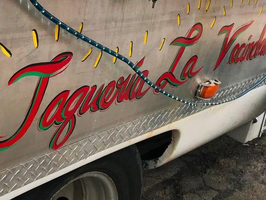 The food truck Taqueria La Vecindad parks near the