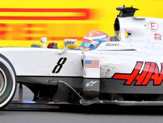 Romain Grosjean powers his Haas F1 car through a corner