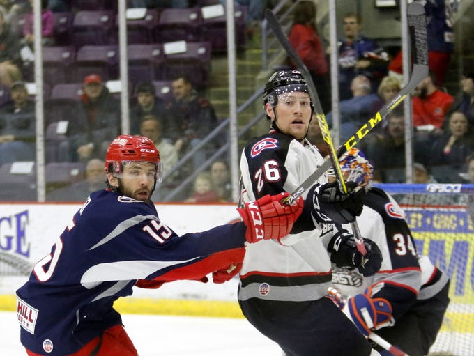 Elmira's Tyler Currier crosses sticks with Brampton's