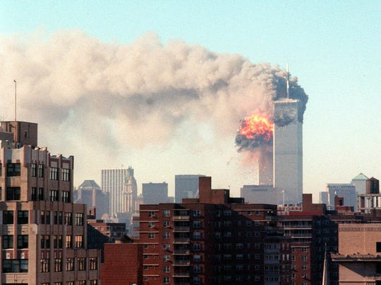 "An explosion engulfs the World Trade Center as the second aircraft hit one of the towers, Sept. 11, 2001. Within a span of 18 minutes, two planes crashed into each of the twin towers of the World Trade Center in Manhattan in what President Bush said in a short announcement was ""a national tragedy and an apparent act of terrorism against our country."""