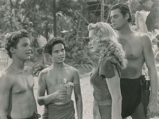 "Real swingers: Johnny Sheffield is Boy, Tommy Cook is Kimba, Brenda Joyce is Jane and Johnny Weissmuller is Tarzan in ""Tarzan and the Leopard Woman."""