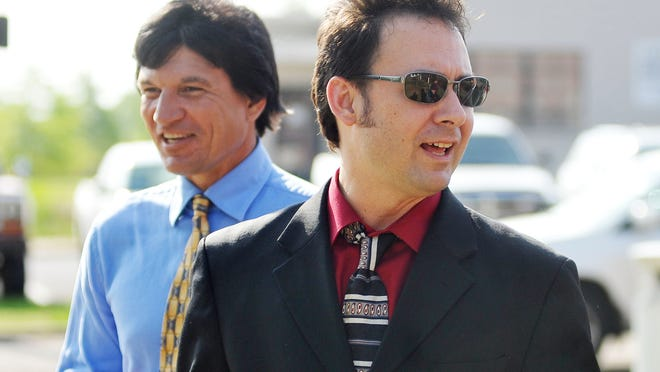 Paul Kevin Curtis, right, who had been in custody under suspicion of sending letters that tested positive for ricin to President Obama, walks to a press conference in Oxford, Miss. on April 23, 2013.