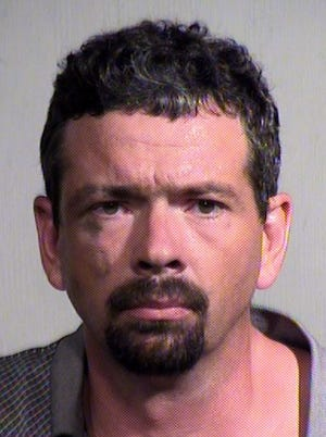 Paul Edward Jarke was arrested after falling asleep at a stoplight in Mesa.