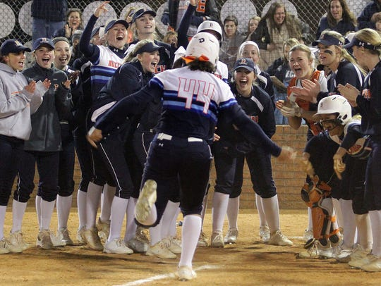 Beech's Kennedy McCurry is welcomed at home plate after
