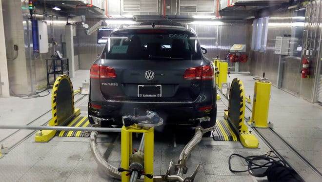 A Volkswagen Touareg diesel is tested in the Environmental Protection Agency's cold temperature test facility in Ann Arbor, Michigan, on Oct. 13. Volkswagen will spend more than $15 billion to settle consumer lawsuits and government allegations that it cheated on emissions tests in what lawyers are calling the largest auto-related class-action settlement in U.S. history.