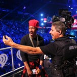 TV personality Nick Cannon, left, poses onstage during the 2014 iHeartRadio Music Festival at the MGM Grand Garden Arena on Sept. 20, 2014, in Las Vegas.