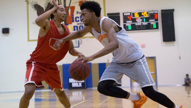 Regis Jesuit's Geoff Kelly guards Corona del Sol's Marvin Bagley III during Best in Basketball Summer Invitational at Sandra Day O'Connor High School in Phoenix on June 26, 2015.
