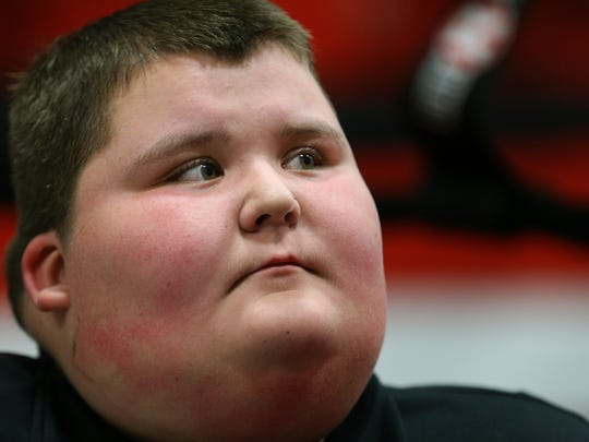 Sixteen-year-old Tyler Rust  during a training session at Rochester Fight Factory.  Trainer Christopher Rhabb ran into Tyler selling lemonade at his roadside stand and offered to help him get healthy. Tyler's father is incarcerated, his mother is battling cancer and he has been bullied in school because of his weight.
