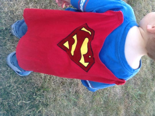 Super Boy joined the EmPoWER FSC and local families at their August Family Movie Night.