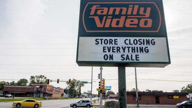The display sign in front of Family Video, 3615 N. Wisconsin Avenue in Peoria, announces the closure of the store.