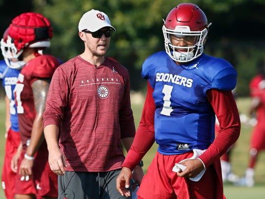 Oklahoma head coach Lincoln Riley watches quarterback Jalen Hurts (1) during an NCAA college football practice in Norman, Okla., Monday, Aug. 5, 2019. (AP Photo/Sue Ogrocki)