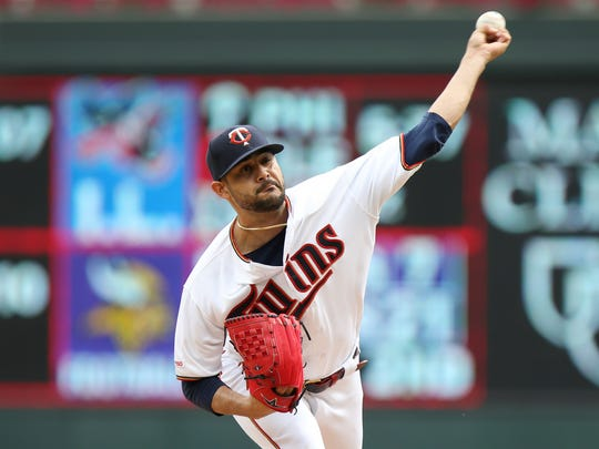 Minnesota Twins pitcher Martin Perez throws against the Kansas City Royals in the first inning of a baseball game Sunday, Sept. 22, 2019, in Minneapolis. (AP Photo/Stacy Bengs)