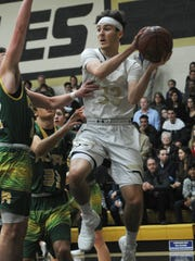 Oak Park's Wes Slajchert looks to pass against Royal during Friday night's game. Slajchert had 26 points in a 92-54 win.