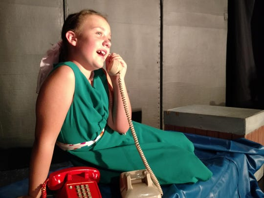 "Reese McClelland of Madison Heights gabs on the phone during a scene from Motor City Youth Theatre's production of ""Bye Bye Birdie."""