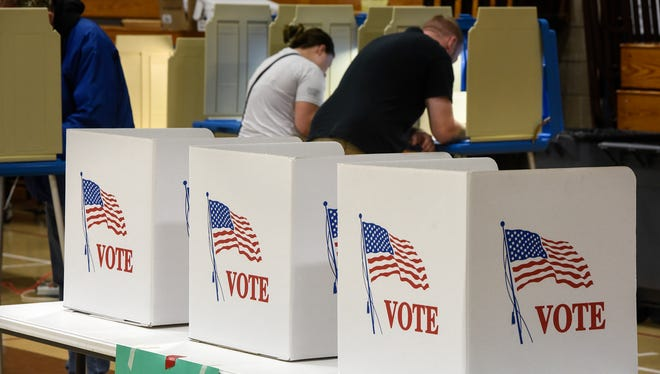 Voters complete their ballots Tuesday, Nov. 8,  at the Sartell Middle School in Sartell.