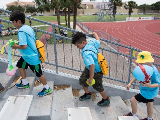 A group of kids in Texas A&M Kingsville's STEM camp walk up the Javelina Stadium bleachers to take part in an egg drop on Thursday, June 29, 2017.