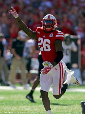 Nebraska Cornhuskers linebacker Thomas Connely (26) celebrates an interception against the Purdue Boilermakers in the first half at Memorial Stadium.