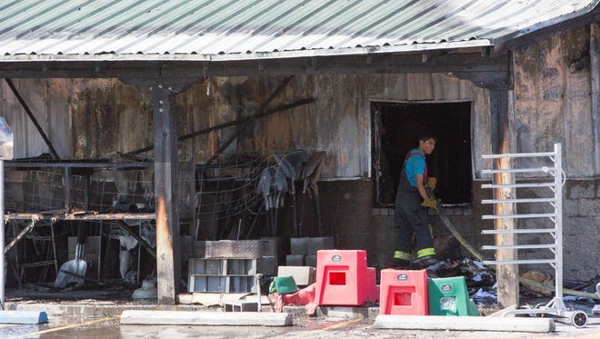Fire crews from Mesquite and Doña Ana County worked the fire at Landmark Mercantile, Tuesday Aug. 29, 2017. The fire broke out at the Mercantile early Tuesday morning.
