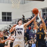 Lakeview's Jared Fisk goes for a lay-up as Mattawan's Tayvian Jones works to block the shot.