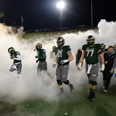 CSU players take the field for the start of the second