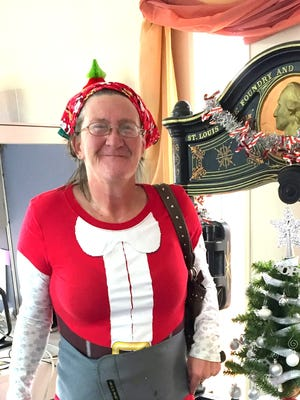 Deming Headlight carrier Violet Murphy made her delivery rounds in festive attire. She came to work dressed for the holiday season and met her customers with a warm season's greeting. Violet has been delivering newspapers in Luna County for several years.