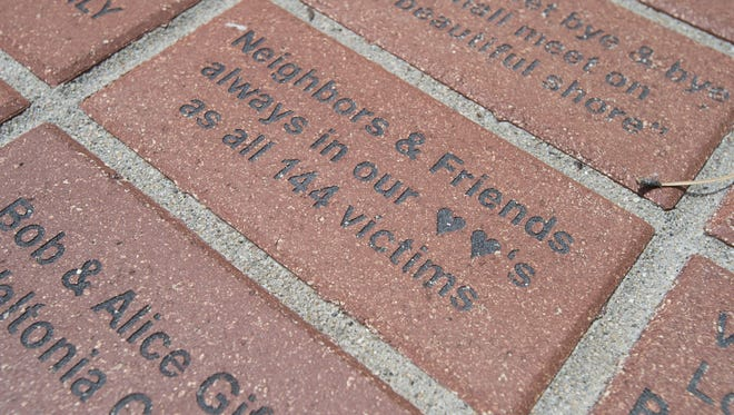 Austin Humphreys/The Coloradoan Bricks serve as a memory of the victims of the 1976 Big Thompson flood in Drake.