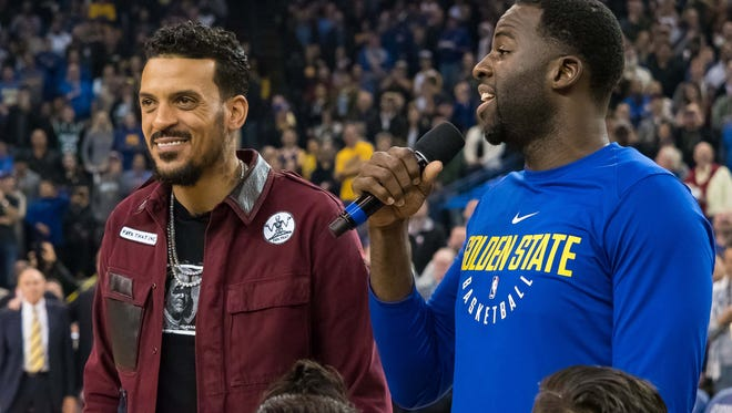 Former Golden State Warriors player Matt Barnes next to forward Draymond Green (23) before receiving his championship ring before the game against the Sacramento Kings at Oracle Arena.