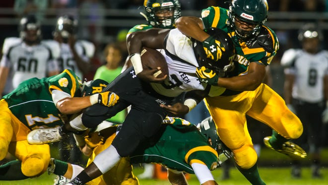 Sussex Tech running back Patrick Griffin (3) is wrapped up by Indian River on Friday evening at Indian River.