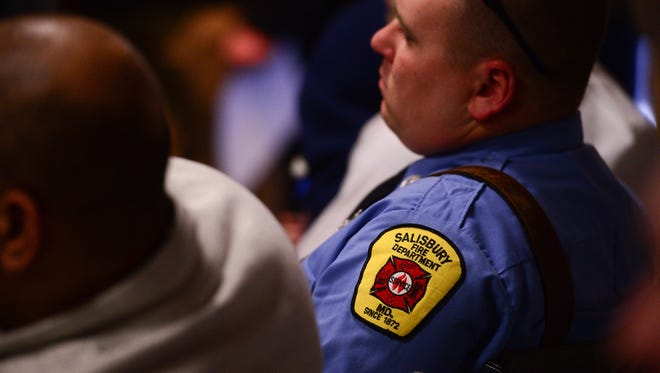 Firefighters sit in a packed room at the Government Office Building in Salisbury on Thursday, March 2, 2017. Volunteer firefighters who have been locked out of Station 1 since deciding to separate from the Salisbury Fire Department were scheduled to meet with the Wicomico County Council at a special meeting Thursday.