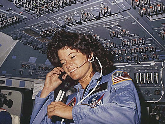 June 18, 1983: This NASA file photo shows America's first woman astronaut Sally Ride, as she communicates with ground controllers from the flight deck during the six-day space mission of the Challenger. Ride first launched into space in 1983, on the seventh US space shuttle mission.