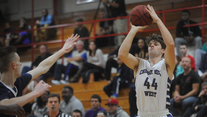 Cherry Hill West senior Jack Goan takes a jumper during  a game against Highland earlier this season. The Lions have turned things around after a dismal 3-7 start.