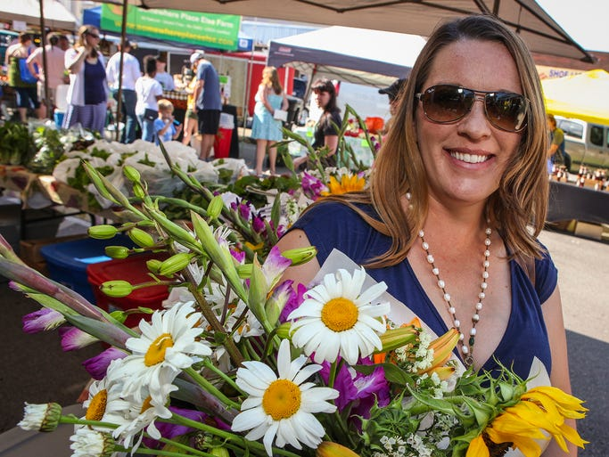 Jessie Boone is happy with the fresh flowers she picked