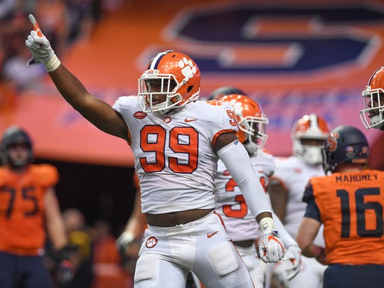 Clemson defensive lineman Clelin Ferrell (99) reacts after a defensive stop against Syracuse during the 2nd quarter on Friday, Oct. 13, 2017 at the Carrier Dome in Syracuse, N.Y.